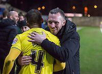 Michael Appleton Manager of Oxford United hugs Kemar Roofe of Oxford United whose 2 goal in the 1st leg was enough to take his side to Wembley during the Johnstone's Paint Trophy Southern Final 2nd Leg match between Oxford United and Millwall at the Kassam Stadium, Oxford, England on 2 February 2016. Photo by Andy Rowland / PRiME Media Images.