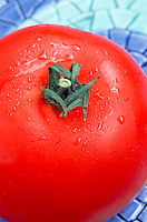 Tomato Celebrity, red, lucious, fresh, just picked, on plate ready to eat