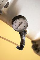 valve and pressure gauge on must pumping tube chateau phelan segur st estephe medoc bordeaux france