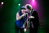 AC/DC - singer Brian Johnson and lead guitarist Angus Young performing live at the Apollo Hammersmith, London - 21 Oct 2003 - Photo by: Awais Butt