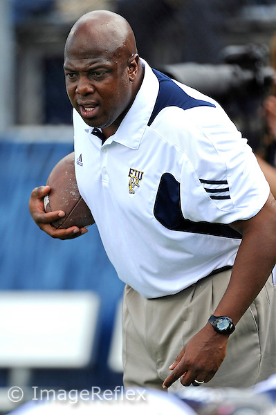 9 October 2010:  FIU Assistant Coach Cedric Calhoun puts his players through drills prior to the game.  The FIU Golden Panthers defeated the Western Kentucky Hilltoppers, 28-21, at FIU Stadium in Miami, Florida.