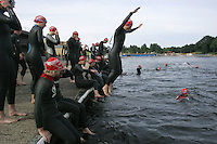 06 AUG 2005 - HOLME PIERREPONT, UK - Competitors prepare for the start of the British Triathlon Club Relay Championships. (PHOTO (C) NIGEL FARROW)
