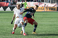 FOXBOROUGH, MA - MARCH 7: Francisco Calvo #5 of Chicago Fire and Adam Buksa #9 of New England Revolution compete for the ball during a game between Chicago Fire and New England Revolution at Gillette Stadium on March 7, 2020 in Foxborough, Massachusetts.