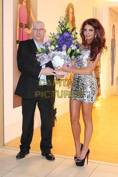 Amy Childs .Opens Her New Clothes Boutique At Eastgate Shopping Centre, Basildon, Essex, UK, 1st December 2012..full length dress mini silver sequined sequin flowers bouquet .CAP/BRC.©Ben Rector/Capital Pictures.