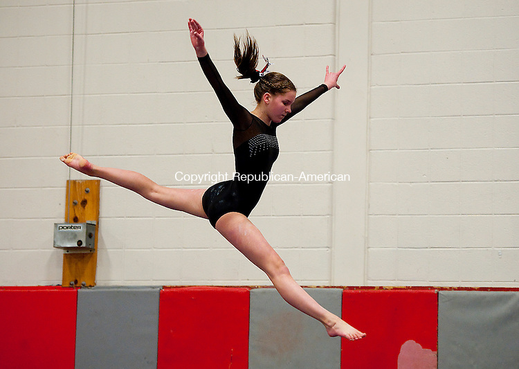 SOUTHBURY, CT--- -012616JS03--Pomperaug's Kaitlyn Furr competes on the beam during their meet Tuesday at Pomperaug High School in Southbury. <br />  Jim Shannon Republican-American