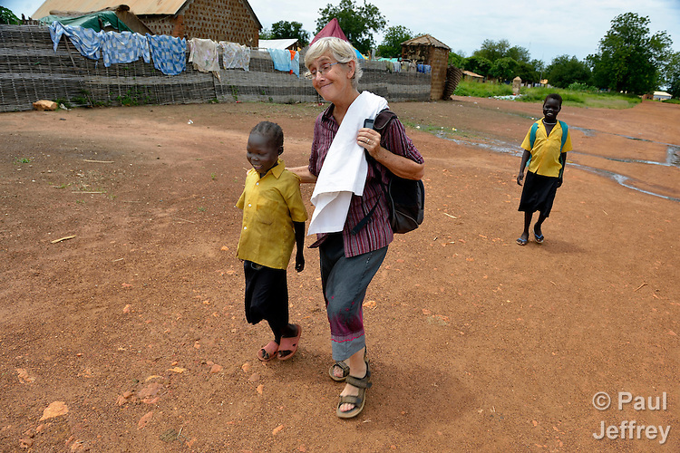 Sister Dorothy Dickson, a member of Sisters of Our Lady of the Missions, walks with a girl on the street in Wau, South Sudan. Dickson is director of the Catholic Health Training Institute in Wau, which trains nurses and midwives in the newly independent country. The Institute is coordinated by Solidarity with South Sudan, an international consortium of more than 200 religious congregations that trains teachers, health workers and pastoral personnel in several locations throughout South Sudan.