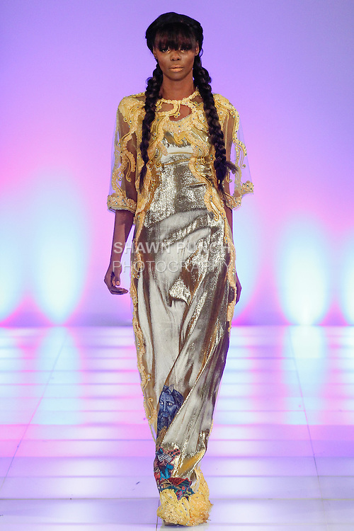 Model walks runway in an outfit from the Danny Nguyen Couture Fall Winter 2014 collection, during Couture Fashion Week Fall 2014, on February 15, 2014.