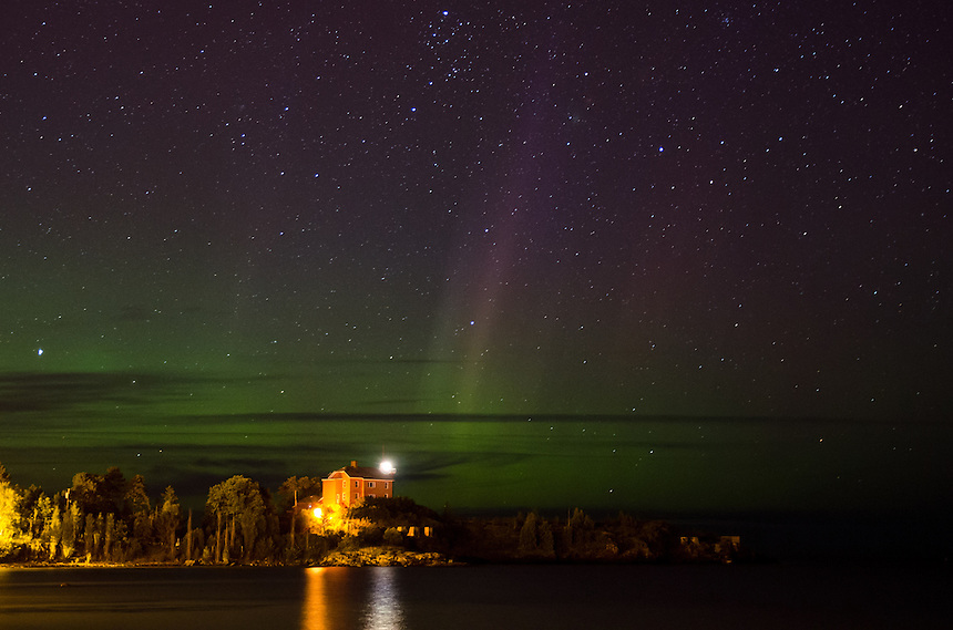 A night view of the Marquette Harbor Lighthouse and the Northern Lights glowing. Marquette, MI