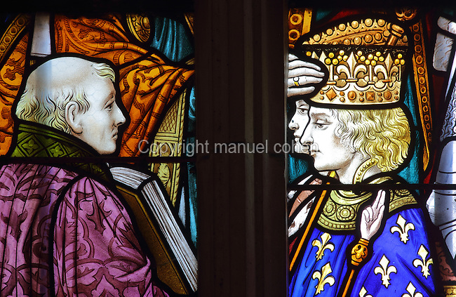 Stained glass window of the Coronation of Charles VII in Reims in 1429, in the St Joan of Arc Chapel, in the Basilique Notre-Dame de l'Epine, or Basilica of Our Lady of the Thorn, L'Epine, Marne, Champagne-Ardenne, France. The church was built 1405-1527 in Flamboyant Gothic style, is listed as a historic monument and as a UNESCO World Heritage Site as part of the Santiago de Compostela pilgrimage site. Picture by Manuel Cohen