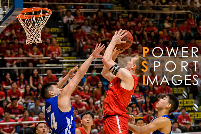 Dominic Robert Gilbert #11 of SCAA Men's Basketball Team tries to score against the Eastern Long Lions during the Hong Kong Basketball League playoff game between Eastern Long Lions and SCAA at Queen Elizabeth Stadium on July 24, 2018 in Hong Kong. Photo by Marcio Rodrigo Machado / Power Sport Images