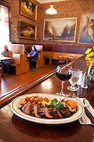 Charbroiled Pork Tenderloin w/  Cumin BBQ Sauce served with Potatoes O'Brien and seasonal vegetables at Baldwin Saloon in The Dalles, Oregon