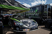 Aug. 16, 2013; Brainerd, MN, USA: The car of NHRA funny car driver Alexis DeJoria sit in the pits during qualifying for the Lucas Oil Nationals at Brainerd International Raceway. Mandatory Credit: Mark J. Rebilas-