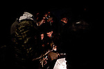 © Remi OCHLIK/IP3 -  Kasserine Tunisia - Saturday 23 January - During the night curfew, people gather around fire, armed with sticks to prevent looters from stealing their house