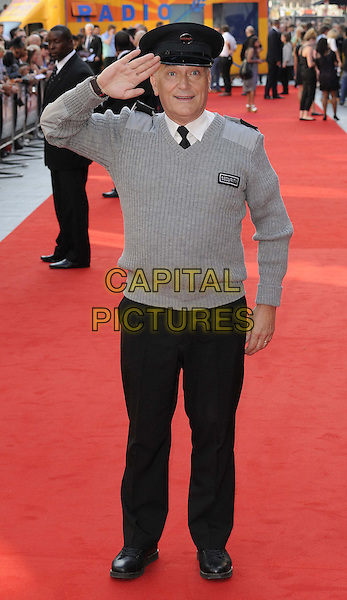 Simon Greenall<br /> attended the &quot;Alan Partridge: Alpha Papa&quot; UK film premiere, Vue West End cinema, Leicester Square, London, England, UK, <br /> 24th July 2013.<br /> full length grey gray jumper uniform hat salute cap hat black trousers security guard <br /> CAP/CAN<br /> &copy;Can Nguyen/Capital Pictures