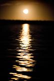 MEXICO, Baja, Magdalena Bay, Pacific Ocean, the moon refelecting on Magdalena Bay