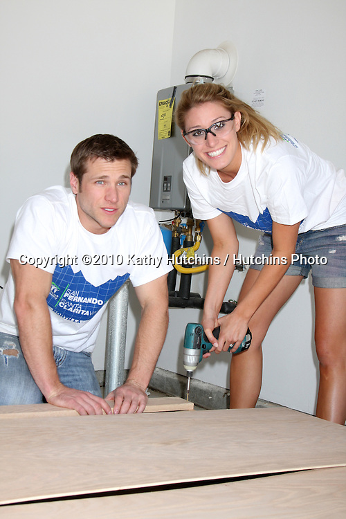 "Jake Pavelka & Finance Vienna Girardi.at the Habitat For Humanity San Fernando/Santa Clarita  Valleys Women Empowerment build assisted by ""The Bachelor Gives Back"".Habitat for Humanity build site, 12600 Carl St..Pacoima, CA.May 22, 2010.©2010 Kathy Hutchins / Hutchins Photo.."
