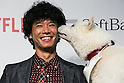 Member of Comedian Group Shinagawa Shoji, Tomoharu Shoji and SoftBank's mascot dog ''Otosan'' (father) pose for the cameras during a media event to announce a business alliance for the Netflix video delivery service in Japan on August 24, 2015, Tokyo, Japan. From September 2nd SoftBank's 37 million users will be able to access a Netflix Inc. subscription starting at 650 JPN (5.34 USD) for a Standard SD plan. The companies also plan to work on joint content creation projects. (Photo by Rodrigo Reyes Marin/AFLO)