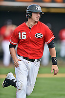 Georgia Bulldogs first baseman Zack Bowers (16) runs to first during a game against the Tennessee Volunteers at Lindsey Nelson Stadium March 21, 2015 in Knoxville, Tennessee. The Bulldogs defeated the Volunteers 12-7. (Tony Farlow/Four Seam Images)