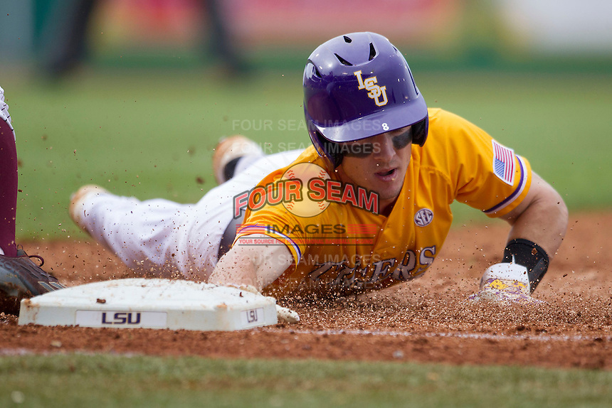 LSU Tigers shortstop Alex Bregman (8) dives back to first base during the Southeastern Conference baseball game against the Texas A&M Aggies on April 25, 2015 at Alex Box Stadium in Baton Rouge, Louisiana. Texas A&M defeated LSU 6-2. (Andrew Woolley/Four Seam Images)