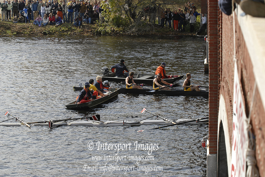 Boston, Massachusetts,  Collegiate Men's Eights, Peking University sink as the come through the  Eliot Bridge, during the Forty Second, [42nd] Head of the Charles, 22/10/2006.  Photo  Peter Spurrier/Intersport Images...[Mandatory Credit, Peter Spurier/ Intersport Images] Rowing Course; Charles River. Boston. USA