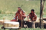 Chumash father and son in traditional regalia drumming for a gathering at Satwiwa American Indian Cultural Center in the Santa Monica Mountains Recreation Area near Los Angeles, CA