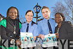 Garda's Diane Collins and Brendan O'Donovan with Charolette Darko left and Olufemi Akilapa who are preparing for the open day in the Killarney Garda Station on St Patrick's  day as part of An Garda Siocha?na 'Your Police Service in Intercultural Ireland' programme