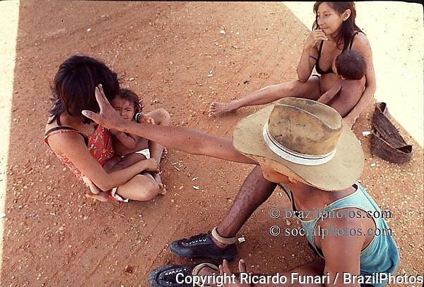 Gold seeker with Yanomami indigenous women...Amazon, Brazil.