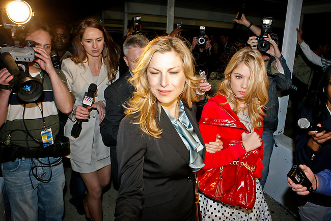 Tatum O'Neal as Principal Lorene Tippit escorts her daughter Brooke Tippit (Ashley Benson) through news crews in the Lifetime Original Movie 'Fab Five: The Texas Cheerleader Scandal.'