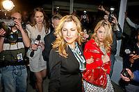 Tatum O'Neal as Principal Lorene Tippit escorts her daughter Brooke Tippit (Ashley Benson) through news crews in the Lifetime Original Movie 'Fab Five: The Texas Cheerleader Scandal.'