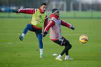 SWANSEA, WALES - JANUARY 28:  Neil Taylor of Swansea City and Dwight Tiendalli of Swansea City chase the ball during training on January 28, 2015 in Swansea, Wales.