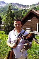 Liechtenstein  Malbun  June 2008.Small town high in the Alpine (southeastern)..Falconry Center.The falconer Norman  Vogeli with predatory  .www.galina.li...