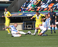 Mark Connolly (left) and Manuel Pascali combine to tackle John McGinn in the Kilmarnock v St Mirren Scottish Professional Football League Premiership match played at Rugby Park, Kilmarnock on 13.9.14.