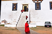 A Buddhist monks seen at the ancient Punakha Dzong (fortress) in Punakha, Bhutan. Phunakha was the capital of Bhutan and the seat of government until 1955, when the capital was moved to Thimphu. Punakha is the administrative centre of Punakha dzongkhag, one of the 20 districts of Bhutan. Photo: Sanjit Das/Panos