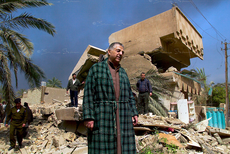 Baghdad, Iraq, March 23, 2003.Ahmed Khamid Al Saadi, 67, in the ruins of his house destroyed by a US bomb the night before.