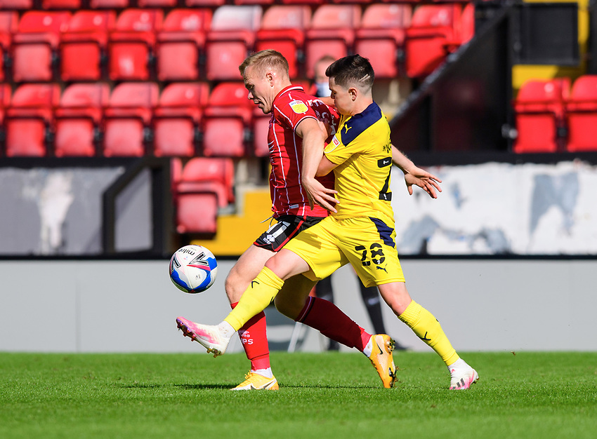 Lincoln City's Anthony Scully is fouled by Oxford United's Liam Kelly<br /> <br /> Photographer Chris Vaughan/CameraSport<br /> <br /> The EFL Sky Bet League One - Saturday 12th September 2020 - Lincoln City v Oxford United - LNER Stadium - Lincoln<br /> <br /> World Copyright © 2020 CameraSport. All rights reserved. 43 Linden Ave. Countesthorpe. Leicester. England. LE8 5PG - Tel: +44 (0) 116 277 4147 - admin@camerasport.com - www.camerasport.com - Lincoln City v Oxford United