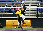 SIOUX FALLS, SD - SEPTEMBER 8: Ty Smith #15 from the University of Sioux Falls hauls in a pass for a touchdown over Etienne Ezeff #1 from Northern State in the first half of their game Saturday night at Bob Young Field in Sioux Falls. (Photo by Dave Eggen/Inertia)