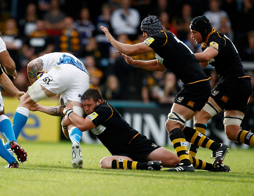 Photo: Richard Lane/Richard Lane Photography. London Wasps v Bath Rugby. 09/10/2011. Wasps' Ben Broster tackles Bath's Ryan Caldwell.