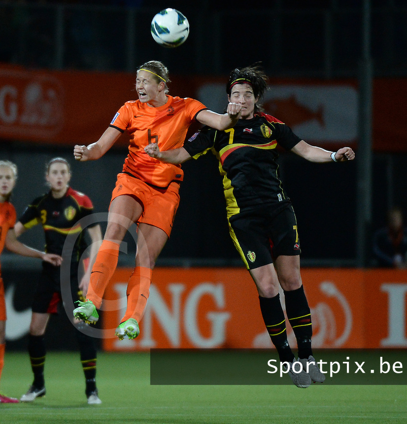 20140212 - ZWOLLE , THE NETHERLANDS : heading duel pictured between Dutch Anouk Dekker (6) and Belgian Cecile De Gernier (7) during the female soccer match between The Netherlands and Belgium , on the fifth matchday in group 5 of the UEFA qualifying round to the FIFA Women World Cup in Canada 2015 at Het Ijseldelta Stadion , Zwolle . Wednesday 12th February 2014 . PHOTO DAVID CATRY