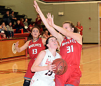 RICK PECK/SPECIAL TO MCDONALD COUNTY PRESS<br /> McDonald County's Ragan Wilson drives to the basket for a layup during the Lady Mustangs' 56-43 win over Reeds Spring on Feb. 11 at MCHS.