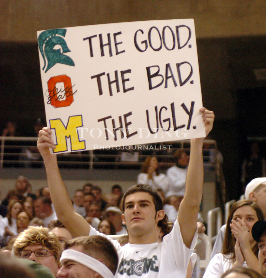"""A fan holds up a sign reading """"The Good, the bad, the ugly"""" during the Wolverines' 54-71 loss to Michigan State on Saturday, January 17, 2004 at the Breslin Center in East Lansing. (TONY DING / The Michigan Daily)"""