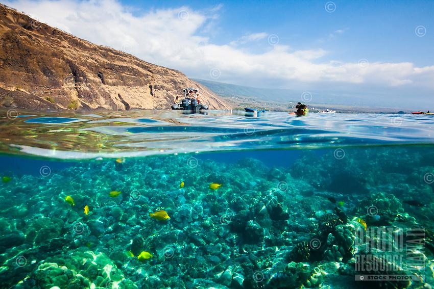 A snorkeler's view of people enjoying the warm waters of Kealakekua Bay, Big Island