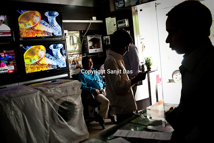 A customer is seen checking prices at Gupta Store in Kailash Colony Market in New Delhi, India.