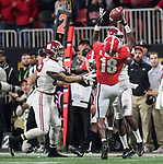 Georgia Bulldogs defensive back Deandre Baker (18) intercepts and Alabama pass in the third quarter of the NCAA College Football Playoff National Championship at Mercedes-Benz Stadium on January 8, 2018 in Atlanta. Photo by Mark Wallheiser/UPI