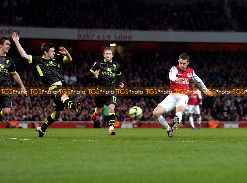 Aaron Ramsey of Arsenal shoots - Arsenal vs Leeds United - FA Cup 3rd Round Football at the Emirates Stadium, London - 09/01/12 - MANDATORY CREDIT: Anne-Marie Sanderson/TGSPHOTO - Self billing applies where appropriate - 0845 094 6026 - contact@tgsphoto.co.uk - NO UNPAID USE.
