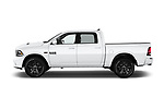 Car driver side profile view of a 2017 Ram 1500 Night Crew 4 Door Pick Up
