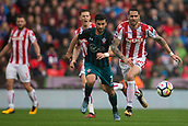 30th September, bet365 Stadium, Stoke-on-Trent, England; EPL Premier League football, Stoke City versus Southampton; Stoke City's Geoff Cameron and Southampton's Shane Long chase a loose ball