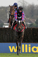 Champion Court ridden by Alain Cawley in jumping action in the Kempton.co.uk Graduation Chase - Horse Racing at Kempton Park Racecourse