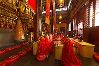 Buddhist monks praying, Jinshan Temple, Jinshan Park, Zhenjiang, China
