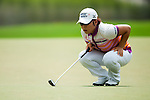 CHON BURI, THAILAND - FEBRUARY 16:  Jiyai Shin of South Korea lines up a putt on the 8th hole during day one of the LPGA Thailand at Siam Country Club on February 16, 2012 in Chon Buri, Thailand.  Photo by Victor Fraile / The Power of Sport Images