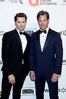 LOS ANGELES - FEB 9:  ANdrew Rannells, Tuc Watkins at the 28th Elton John Aids Foundation Viewing Party at the West Hollywood Park on February 9, 2020 in West Hollywood, CA